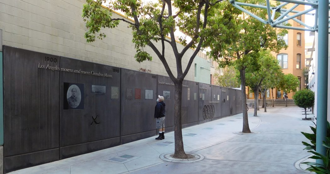 Biddy Mason Memorial Park at 333 South Spring Street, designed by landscape architects Katherine Spitz and Pamela Burton. The artwork Biddy Mason Time and Place is an 80-foot-long poured concrete wall by artist Sheila Levrant de Bretteville.